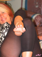 Nikki's sexy bare feet with toes spread